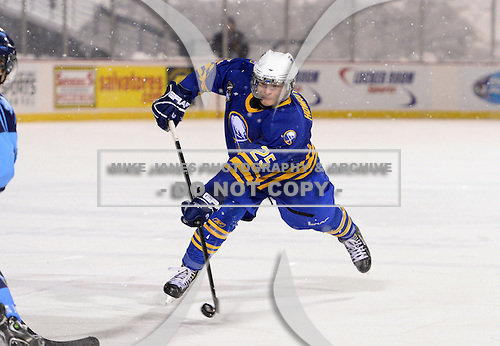 Buffalo Junior Sabres defensemen Dylan Howatt (25) during a game against the St. Michaels Buzzers at the Frozen Frontier outdoor game at Frontier Field on December 15, 2013 in Rochester, New York.  St. Michael's defeated Buffalo 5-4.  (Copyright Mike Janes Photography)
