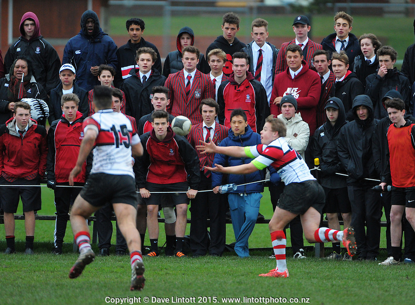 Action from the Wellington secondary schools rugby union semifinal between Scots College (red white and black) and Wellington College (black white and yellow) at Scots College, Wellington, New Zealand on Saturday, 1 August 2015. Photo: Dave Lintott / lintottphoto.co.nz