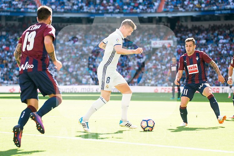 Real Madrid's player Toni Kroos and Eibar FC's player Antonio Luna and Ruben Peña Jimenez during a match of La Liga Santander at Santiago Bernabeu Stadium in Madrid. October 02, Spain. 2016. (ALTERPHOTOS/BorjaB.Hojas)