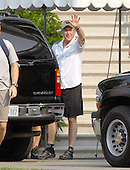 Washington, D.C. - June 2, 2007 -- United States President George W. Bush waves as he departs the White House in Washington, D.C. on Saturday, June 2, 2007.  He was departing to go biking, one of his favored forms of exercise.<br /> Credit: Ron Sachs - Pool via CNP