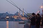 Yeni Camii Mosque,  Fishermen on the Galata Bridge, Golden Horn, Istanbul, Turkey,