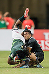 Sione Molia of New Zealand tackles Branco Du Preez of South Africa during the match South Africa vs New Zealand, Day 2 of the HSBC Singapore Rugby Sevens as part of the World Rugby HSBC World Rugby Sevens Series 2016-17 at the National Stadium on 16 April 2017 in Singapore. Photo by Victor Fraile / Power Sport Images