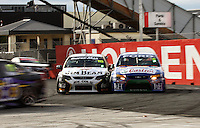 James Courtney passes Steven Richards to move into third place at Holden Hairpin during Day Three of the Hamilton 400 Aussie V8 Supercars Round Two at Frankton, Hamilton, New Zealand on Sunday, 19 April 2009. Photo: Dave Lintott / lintottphoto.co.nz