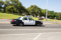 An Austin Police Department (APD) patrol car speeds down the street on route to an emergency.<br />