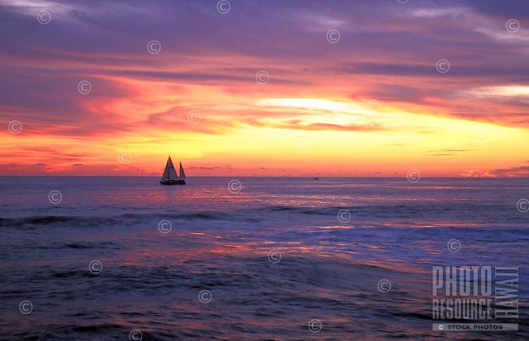 Catamaran sailing at sunset off the south coast of the island of Oahu