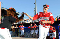 Batavia Muckdogs pitcher Robert Ravago #34 high fives mascot Homer while being introduced before a game against the Auburn Doubledays on June 18, 2013 at Dwyer Stadium in Batavia, New York.  Batavia defeated Auburn 10-2.  (Mike Janes/Four Seam Images)