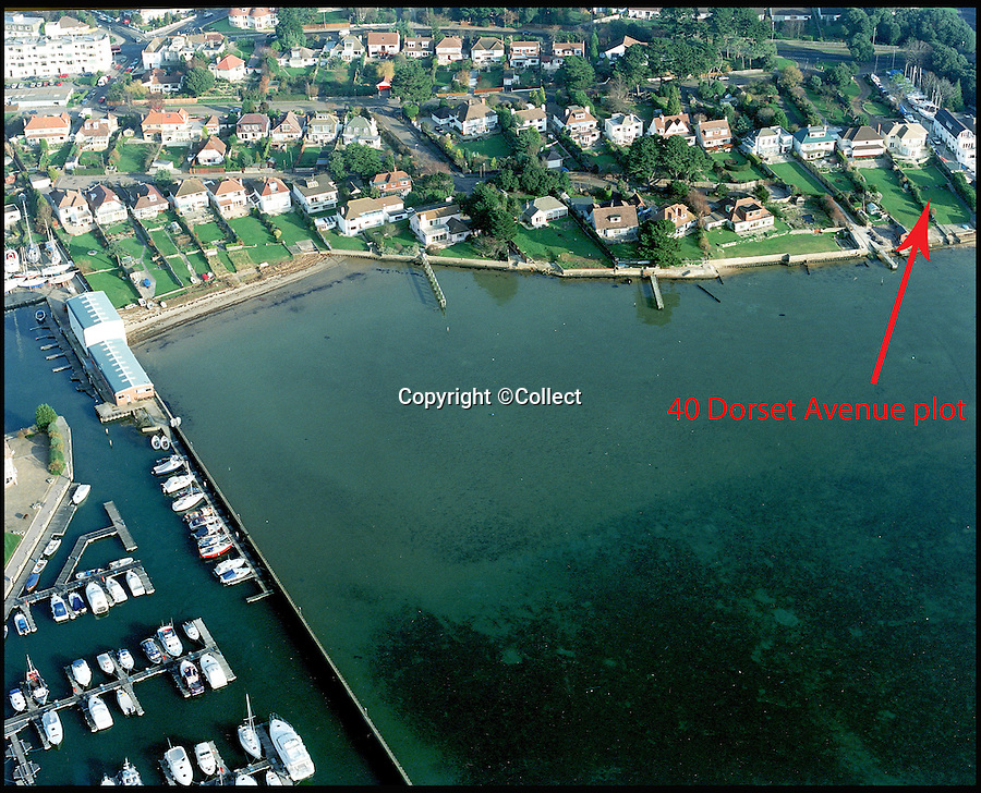 BNPS.co.uk (01202 558833)<br /> Pic: Collect<br /> <br /> An aerial view of the Poole harbour and the plot of land.<br /> <br /> This empty plot of land has gone on the market for a staggering £3.5 million because it is situated NEAR the exclusive address of Sandbanks.<br /> <br /> The narrow parcel of land has nothing on it apart from some overgrown grass, the footings of an old house and a shabby-looking driveway.<br /> <br /> But looking at the property from another point of view reveals why it can command such a hefty asking price as it boasts some of the finest seaside views in the country.