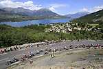 The 50+ breakaway group start to climb Cote de Demoiselles Coiffees at Lac de Serre-Poncon during Stage 18 of the 104th edition of the Tour de France 2017, running 179.5km from Briancon to the summit of Col d'Izoard, France. 20th July 2017.<br /> Picture: Eoin Clarke | Cyclefile<br /> <br /> All photos usage must carry mandatory copyright credit (&copy; Cyclefile | Eoin Clarke)