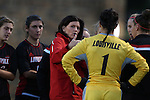 04 October 2014: Louisville head coach Karen Ferguson-Dayes (in red) talks to her players before the game. The Duke University Blue Devils hosted the University of Louisville Cardinals at Koskinen Stadium in Durham, North Carolina in a 2014 NCAA Division I Women's Soccer match. The game ended in a 0-0 tie after double overtime.