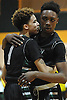 KC Ndefo #4 of Elmont, right, gets a congratulatory hug from teammate #1 Yasir Lawrence after sinking a free throw to seal a 55-51 double overtime win over South Side in the Nassau County varsity boys basketball Class A final at LIU Post on Saturday, Feb. 27, 2016.