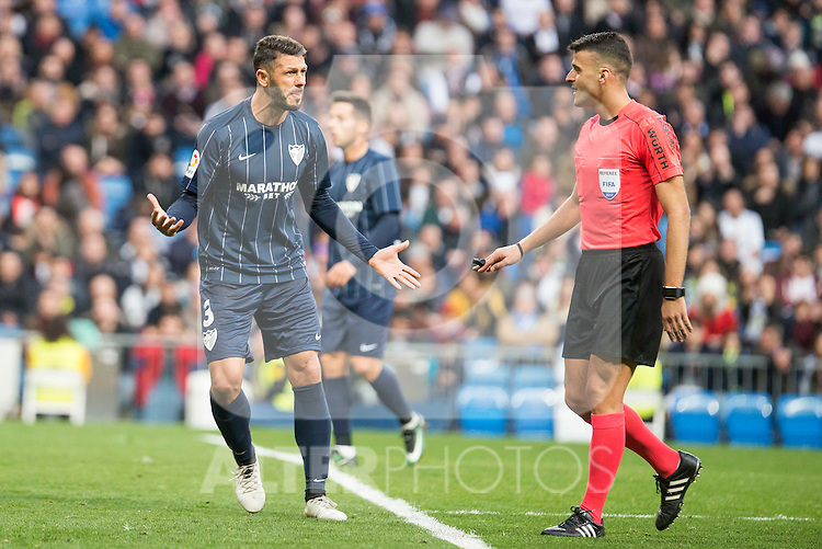 Malaga CF's Weligton Robson talking with the referee during La Liga match between Real Madrid and Malaga CF at Santiago Bernabeu Stadium in Madrid, Spain. January 21, 2017. (ALTERPHOTOS/BorjaB.Hojas)