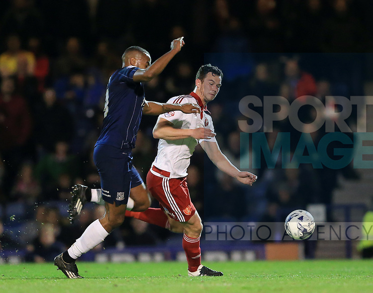 Southend's Tyrone Barnett tussles with Sheffield United's Harrison McGahey during the League One match at Roots Hall Stadium.  Photo credit should read: David Klein/Sportimage