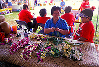 Local Hawaiian women practice the art of Lei making as part of the annual Aloha Festival. This photo taken in the town of Lehui on the island of Kauai during the aloha festivities.