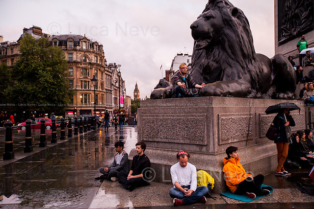 London, 21/09/2015. Today, to mark the International Peace Day - unofficially known as World Peace Day - hundreds of people gathered in Trafalgar Square &lt;&lt;[&hellip;] for a half an hour sitting in peace in Trafalgar Square on World Peace Day for a #HappierWorld . London is a place where few are at peace: rushing, pushing and competing to get ahead, leaving millions stressed out and unhappy. By sitting peacefully together in the middle of Trafalgar Square we'll send a message that happiness and peace are best pursued by looking deep inside ourselves and committing to taking action. Join us for a more peaceful and #HappierWorld&gt;&gt; (from the organisers Facebook page).<br /> <br /> For more information please click here: http://on.fb.me/1Fp6Maq