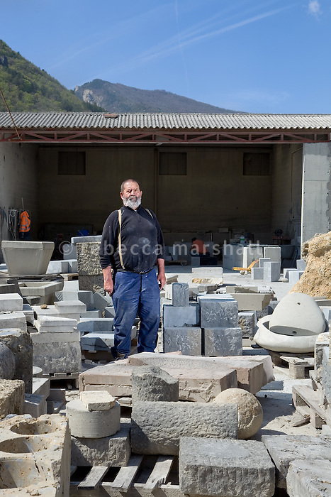 Pierre Gavazzi, stonemason (tailleur de pierre) poses for the photographer at Annot quarry, Annot, France, 26 April 2010