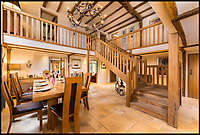 BNPS.co.uk (01202 558833)<br /> Pic:  KnightFrank/BNPS<br /> <br /> A luxury property in the real-life setting for the Winnie the Pooh books that even has a stream running through it connecting to 'Pooh Bridge' is up for sale.<br /> <br /> Hatfield Hall is in the same village author AA Milne lived when he was inspired to write his famous children's stories in the 1920s.<br /> <br /> Hatfield is within Ashdown Forest which Milne called Five Hundred Acre Wood and is where Christopher Robin, Pooh, Piglet and Eeyore had their adventures.<br /> <br /> Their most famous escapade was inventing the game of Pooh-sticks at a wooden bridge in the forest.