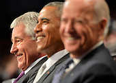 United States President Barack Obama (C) joins outgoing Secretary of Defense Chuck Hagel (L) and Vice President Joe Biden in a laugh as they attend the Armed Forces Farewell Tribute for Hagel, January 28, 2015 at Joint Base Myer-Henderson Hall, Virginia. Deputy Secretary Ashton Carter, who has served under Leon Panetta and Hagel is expected to be easily approved by the Senate to replace Hagel.                                     <br /> Credit: Mike Theiler / Pool via CNP