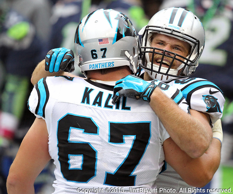 Carolina Panthers tight end Geg Olsen (88) celebrates with center Ryan Kalil (67) at CenturyLink Field in Seattle on October 18, 2015 after catching the winning touchdown against the Seattle Seahawks. The Panthers came from behind with 32 seconds remaining in the 4th Quarter to beat the Seahawks 27-23.  ©2015 Jim Bryant Photography. All Rights Reserved.