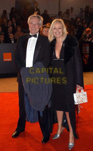 BARRY NORMAN & DAUGHTER.The Orange British Film Academy Awards BAFTAS at Odeon Leicester Square.www.capitalpictures.com.sales@capitalpictures.com.© Capital Pictures