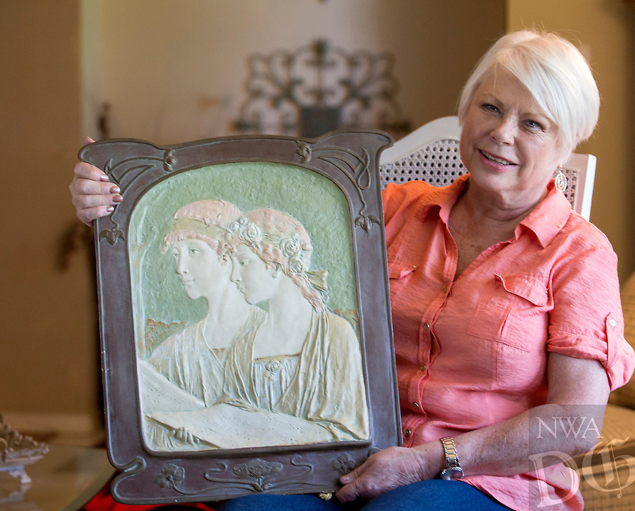 NWA Democrat-Gazette/JASON IVESTER --06/10/2015--<br /> Chris Bell plans to take her Ernst Wahliss porcelain art to the Antiques Road Show in Little Rock in July. photographed on Wednesday, June 10, 2015, inside her Fayetteville home