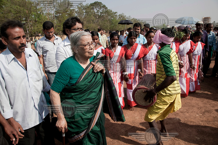 Mahasweta Devi leads a protest rally by Santal Adavesi tribespeople on the West Bengal / Jharkhand border. They were protesting the destruction of their land as a consequence of the excavation of a stone quarry. Mahasweta Devi is one of India's best-known activists and writers. She has produced both fiction and non-fiction books dealing with the plight of India's poor and dispossessed, especially women and Adivasis (India's indigenous tribes). In addition to her writing, she has led numerous protests and actions against Indian government policies that oppress the poor...