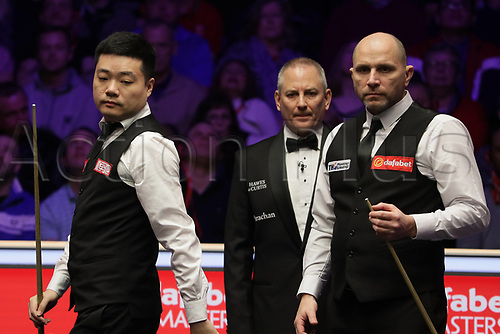 12th January 2020, Alexandra palace, London, United Kingdom; Ding Junhui of China L looks across the table during the round 1 match between Ding Junhui of China and Joe Perry of England at Snooker Masters 2020 at the Alexandra Palace . Perry won 6 frames to 3.