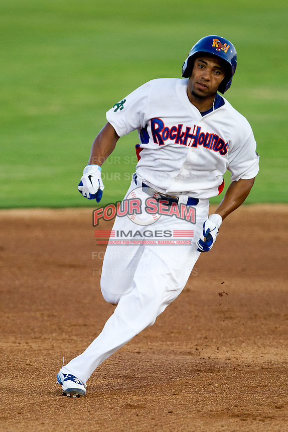 Jermaine Mitchell (25) of the Midland Rockhounds heads to third base during a game against the North All-Stars 2011 in the Texas League All-Star game at Nelson Wolff Stadium on June 29, 2011 in San Antonio, Texas. (David Welker / Four Seam Images)..
