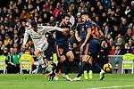 Real Madrid's Sergio Reguilon and Valencia CF's Daniel Parejo during La Liga match between Real Madrid and Valencia CF at Santiago Bernabeu Stadium in Madrid, Spain. December 01, 2018. (ALTERPHOTOS/A. Perez Meca)
