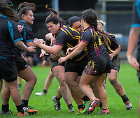 Action from the New Zealand Secondary Schools Girls Top 4 rugby semfinal between Hamilton Girls' High School (black maroon and gold) and Southern Cross Campus College (black and teal) at Arena Manawatu, Palmerston North, New Zealand on Friday, 4 September 2015. Photo: Dave Lintott / lintottphoto.co.nz