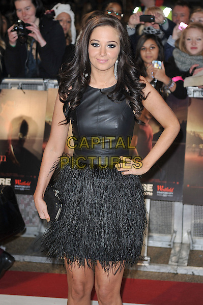 Tulisa Contostavlos.'The Twilight Saga: Breaking Dawn - Part 1' UK film premiere at Westfield Stratford City, London, England..16th November 2011.half length dress feather skirt hand on hip clutch bag black sleeveless .CAP/MAR.© Martin Harris/Capital Pictures.
