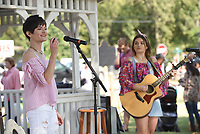 NWA Democrat-Gazette/FLIP PUTTHOFF<br />SONGS AT CENTERTON DAY<br />Gabby Chronister (left) and Sidney Patrick sing Saturday Sept. 9 2017 at Centerton city park during the annual Centerton Day. The pair perform as the duo, RaeCam.The event included a parade, car show, dunk tank, tiny tot pageant, fish fry and more at the park and other venues in Centerton.