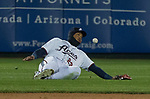 Aces outfielder Yasmany Tomas can't make the catch during the 2019 opening day game between the Reno Aces and the Albuquerque Isotopes at Greater Nevada Field in Reno, Nevada on Tuesday, April 9, 2019.