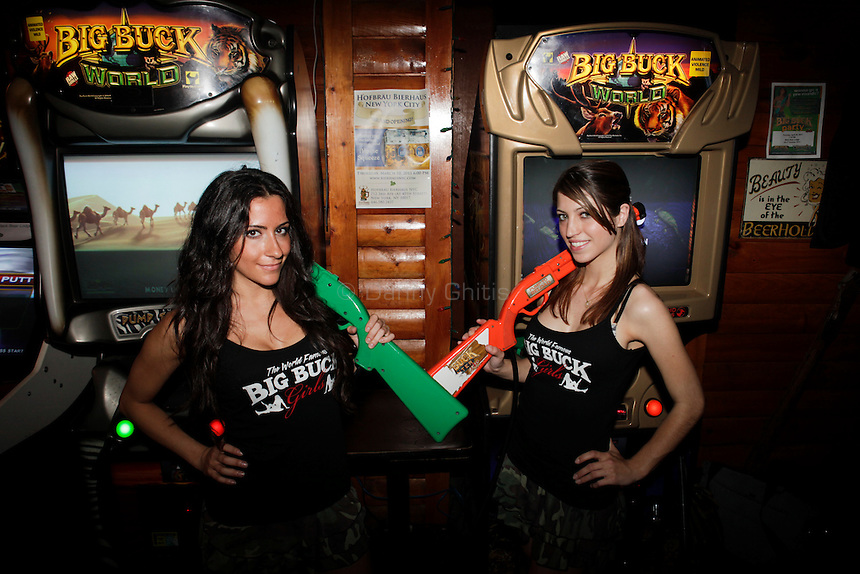 Big Buck Girls Andrea Miele, 23, left, and Alicia Patterson, 24, pose for a portrait at The Black Bear Lodge in Manhattan, which hosted an official Big Buck Party on Thursday April, 28, 2011. Fans of the popular hunting arcade game were invited to test their skill against other Big Buck Hunter fans to compete for prizes, enter to win raffle merchandise and meet Big Buck Girls...Danny Ghitis for The New York Times