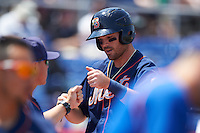 Binghamton Mets left fielder Jayce Boyd (3) fist bumps teammates after scoring a run during a game against the Richmond Flying Squirrels on June 26, 2016 at NYSEG Stadium in Binghamton, New York.  Binghamton defeated Richmond 7-2.  (Mike Janes/Four Seam Images)