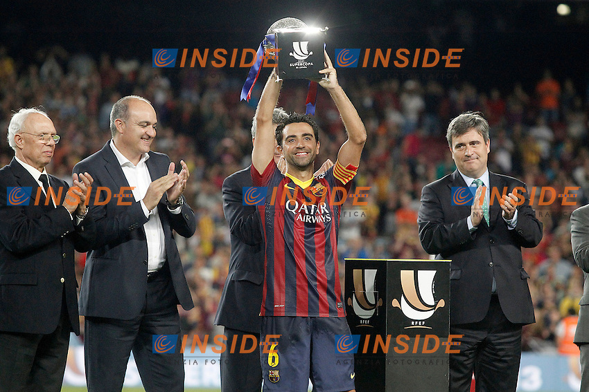 FC Barcelona's Xavi Hernandez with the winner trophy of the  Supercup of Spain.August 28,2013. (ALTERPHOTOS/Acero) <br /> Football Calcio 2013/2014<br /> La Liga Spagna Supercoppa di Spagna Barcellona - Atletico MAdrid <br /> Foto Alterphotos / Insidefoto <br /> ITALY ONLY