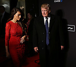 Melania Trump and Donald Trump  attends the Opening Night performance of 'New York Spring Spectacular' at Radio City Music Hall on March 26, 2015 in New York City.