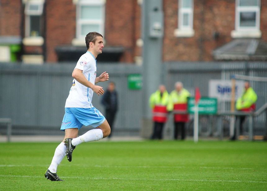 Coventry City's Danny Pugh celebrates after his free kick was deflected into the goal by Crewe Alexandra's Anthony Grant<br /> <br /> Photographer Chris Vaughan/CameraSport<br /> <br /> Football - The Football League Sky Bet League One - Crewe Alexandra v Coventry City - Saturday 11th October 2014 - Alexandra Stadium - Crewe<br /> <br /> &copy; CameraSport - 43 Linden Ave. Countesthorpe. Leicester. England. LE8 5PG - Tel: +44 (0) 116 277 4147 - admin@camerasport.com - www.camerasport.com