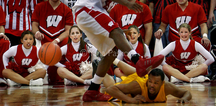 The Wisconsin Dance Team watches in horror as the foot of UW-Madison's Alando Tucker (#42, on the left, above,) and the head of a Minnesota Golden Gophers' player (on the right, below,) collide during the Feb. 26, 2006 men's basketball game.