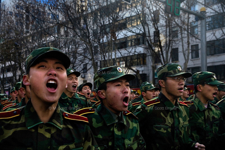 Army troops shout in time while marching through the streets of Nanjing, Jiangsu, China, during a New Year's Day parade.