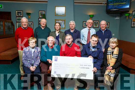 John O'Brien from Riverside, Oakpark been presented with his winning cheque of €11,000 from the Na Gaeil GAA lotto on Tuesday night at the club.<br /> Seated l to r: Mary Maunsel, Pat O'Connor, John O'Brien and Cathy Carey.<br /> Back l to r: Joe Clifford, Sean O'Connor, Helen Cooper, Michael Herlihy, Pat Cleary and Donal Lucey.