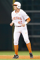 Kacy Clemens #42 of the Texas Longhorns takes his lead off of second base against the Rice Owls at Minute Maid Park on February 28, 2014 in Houston, Texas.  The Longhorns defeated the Owls 2-0.  (Brian Westerholt/Four Seam Images)