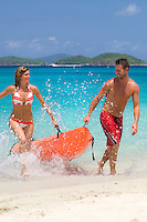 Couple at the beach with a kayak<br />