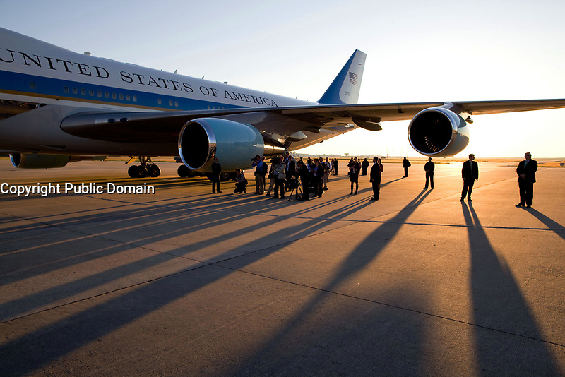 The press pool gathers under the wing of Air Force One, prior to President Barack Obama's departure from George Bush Intercontinental Airport, in Houston, Texas, Oct. 16, 2009.  (Official White House Photo by Pete Souza)<br /> <br /> This official White House photograph is being made available only for publication by news organizations and/or for personal use printing by the subject(s) of the photograph. The photograph may not be manipulated in any way and may not be used in commercial or political materials, advertisements, emails, products, promotions that in any way suggests approval or endorsement of the President, the First Family, or the White House.