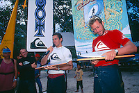 Quiksilver Pro, Grajagan, East Java. Indonesia <br /> The 1995 Quisksilver Pro  held in the waves of  Grajagan, better known as G-Land, on the coastline of a nature reserve on the southern-most tip of east Java was won by Kelly Slater (USA) with fellow Quiksilver surfer Jeff Booth (USA) in second place.  It was the first Quiksilver Pro, G-Land, that set the true concept of the ASP &lsquo;Dream Tour&rsquo; in motion. The late 80s and early 90s saw a growth in events based close to metropolitan areas, but the Quiksilver Pro, G-Land took a step away from that. Its emphasis was on quality waves, rather than quality crowds. Surfer Magazine calls Quiksilver's G-Land Java Pro &ldquo;The greatest ASP contest ever . . .&rdquo;. Surfing Magazine says, &ldquo;More than a contest, more than a surf trip, the Quiksilver Pro redefined professional surfing . . .&rdquo; Witness a select group of the worlds greatest surfers in some of the best contest waves ever ridden.&quot;  Lto R Rod Brooks (AUS), Bruce Raymond (AUS), Kelly Slater (USA) and Jeff Booth (USA).  Photo: joliphotos.com