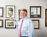 March 15, 2017. Charlotte, North Carolina.<br /> <br /> Pat Swisher in his office. He is pointing to a photo of his son and baseball star Reggie Jackson.<br /> <br /> Pat Swisher is the founder of of both Swisher Hygiene and Enviro-Master Services, both janitorial serve and product franchise companies.