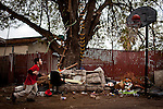 Ten-year-old Benito Tirjeron plays basketball at his home in the Parklawn neighborhood of Modesto, Calif., March 1, 2012.