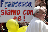 "Papa Francesco celebra la messa per la Domenica delle Palme in Piazza San Pietro, Citta' del Vaticano, 24 marzo 2013..Pope Francis celebrates the Palm Sunday Mass in St. Peter's square at the Vatican, 24 March 2013. The sign reads ""Francis, we are with you!""..UPDATE IMAGES PRESS/Riccardo De Luca..STRICTLY ONLY FOR EDITORIAL USE"