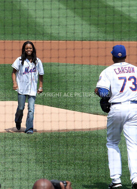 WWW.ACEPIXS.COM . . . . .  ....August 23 2012, New York City....US Olympic gold medalist Gabrielle Douglas throws the ceremonial first pitch at the Rockies vs Mets baseball game at Citi Field on August 23 2012 in New York City....Please byline: Zelig Shaul - ACE PICTURES.... *** ***..Ace Pictures, Inc:  ..Philip Vaughan (212) 243-8787 or (646) 769 0430..e-mail: info@acepixs.com..web: http://www.acepixs.com