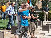 Matt Swanson '14 (blue shirt) hugs Oxy President Jonathan Veitch. Rehearsal for commencement, including the traditional water balloon fight, Friday, May 16, 2014. (Photo by Marc Campos, Occidental College Photographer) Matt Swanson '14 (blue shirt) trades water balloons with Jonathan Veitch.