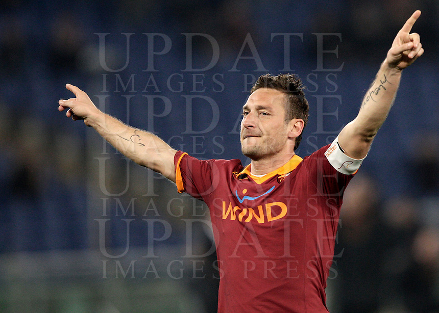 Calcio, Serie A: Roma vs Genoa. Roma, stadio Olimpico, 3 marzo 2013..AS Roma forward Francesco Totti celebrates after scoring  on a penalty kick during the Italian Serie A football match between AS Roma and Genoa at Rome's Olympic stadium, 3 March 2013..UPDATE IMAGES PRESS/Riccardo De Luca